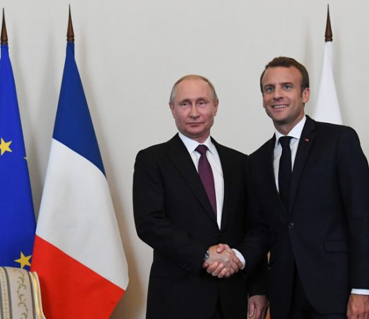 Russian President Vladimir Putin (R) shakes hands with French President Emmanuel Macron during a meeting in St. Petersburg, Russia May 24, 2018. Kirill Kudryavtsev Reuters