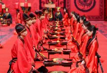 FILE PHOTO: Couples attend a group wedding ceremony in Hunan province, China © Reuters