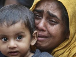 FILE PHOTO: A Rohingya Muslim woman cries as she holds her daughter after they were detained by Border Security Force (BSF) soldiers while crossing the India-Bangladesh border - Copyright REUTERS/Jayanta Dey/File Photo