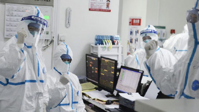 Members of the medical staff work at the Central Hospital in Wuhan, China. © Central Hospital of Wuhan via Sputnik
