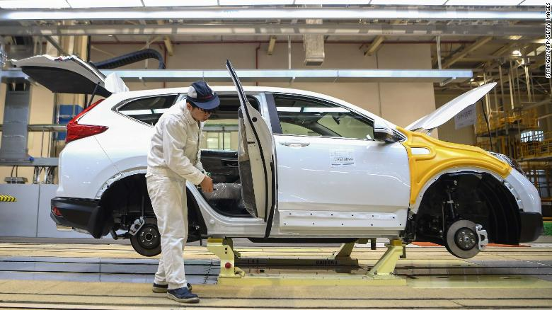 An employee works on an assembly line at Dongfeng Honda in Wuhan.