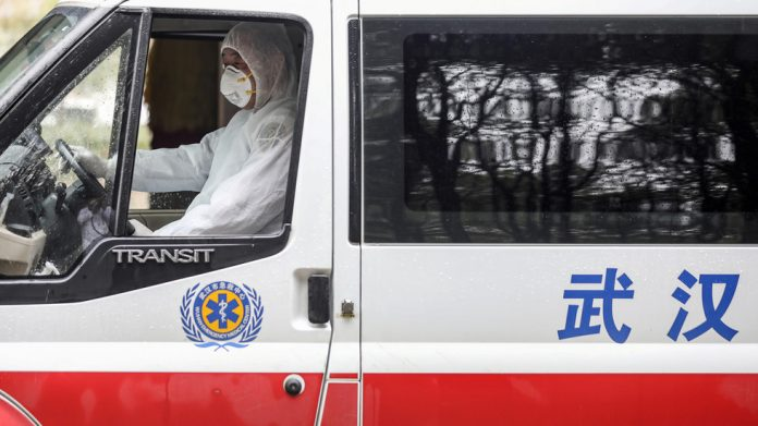 A medical worker drives an ambulance before disinfecting it at Jinyintan hospital in Wuhan © China Daily via REUTERS