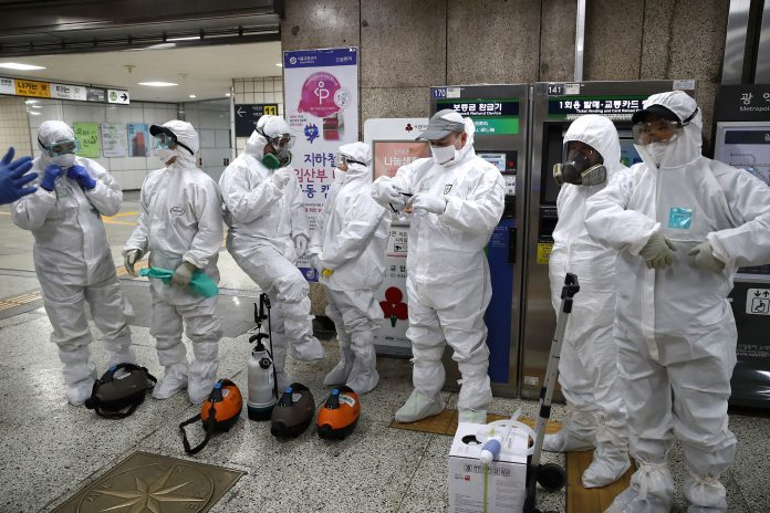 Workers prepare to disinfect a subway station in Seoul on Friday. Chung Sung-Jun/Getty Images