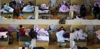 Coronavirus patients rest at a temporary hospital converted from a sports center in Wuhan, Hubei province on Monday, February 17. Xiao Yijiu/Xinhua via AP