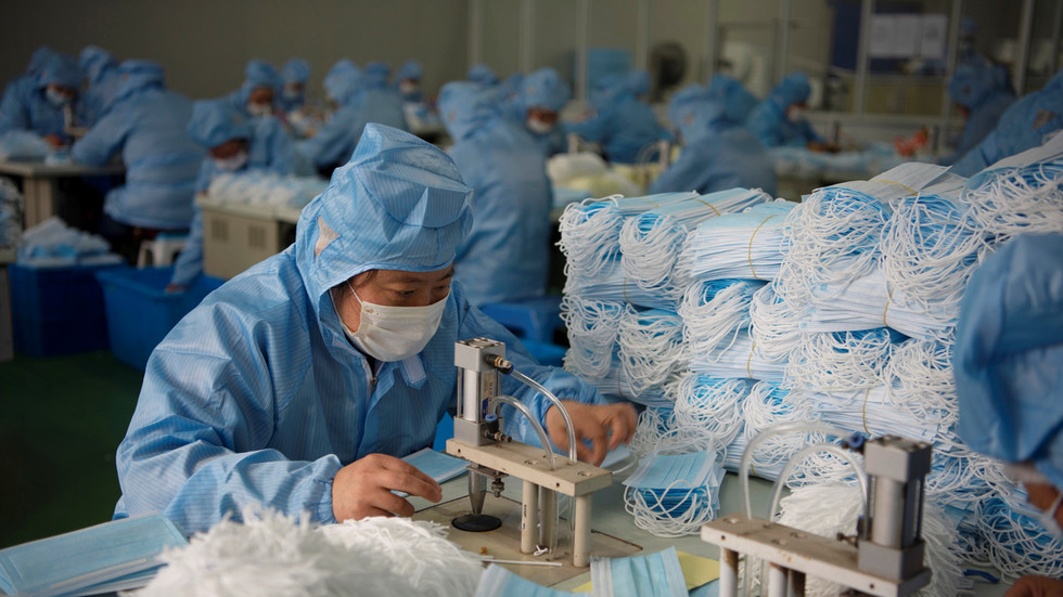 FILE PHOTO: A production line for surgical masks at a factory in Nantong, China © Reuters